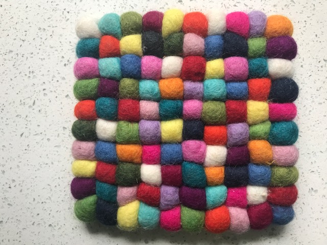 A group of multi-coloured felt bobbles