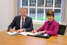 Barry Mulholland, CSSC Chief Executive pictured with Dr Anne Heaslett, Principal of Stranmillis University College .