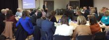 Audience of local school leaders listen to welcome to round table event