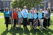 CSSC staff with fundraising total for Cancer Focus