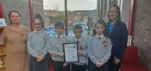 Pupils and staff from Fountain Primary School with School of Sanctuary award
